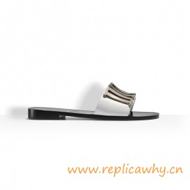 Calfskin Mule Adorned with a Tone Metallic Brand Logo